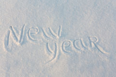 Happy New Year written on snow Royalty Free Stock Photos
