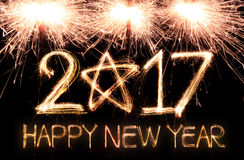 Happy new year 2017. Written with Sparkle firework Stock Images