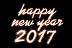 2017. Happy new year 2017 written with Sparkle firework on black background Royalty Free Stock Image