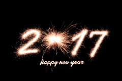 2017. Happy new year 2017 written with Sparkle firework on black background stock photo