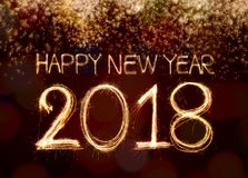 2018. Happy new year 2018 written with Sparkle firework and firework background stock photos