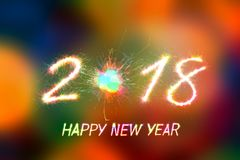 2018. Happy new year 2018 written with Sparkle firework and firework background Royalty Free Stock Photos