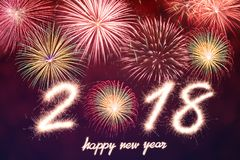 2018. Happy new year 2018 written with Sparkle firework and firework background Royalty Free Stock Image