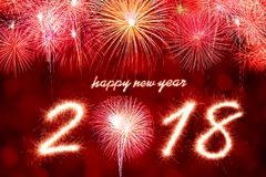 2018. Happy new year 2018 written with Sparkle firework and firework background Stock Images