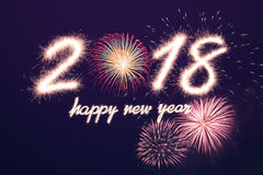 2018. Happy new year 2018 written with Sparkle firework with firework background Royalty Free Stock Photos