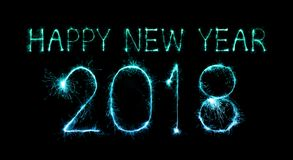 Happy new year 2018 written with Sparkle firework. At night Stock Images