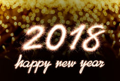 Happy new year 2018. Written with Sparkle firework over bokeh background Stock Image