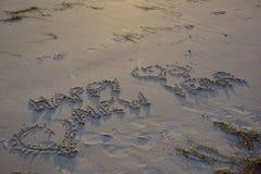 Happy new year. Written text on the beach Stock Photos