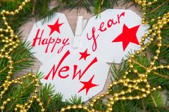 Happy New Year written on white sheets Stock Photography