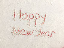 Happy New Year written on white snow Royalty Free Stock Image