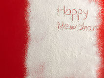 Happy New Year written on white snow Stock Images