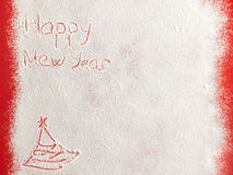 Happy New Year written on white snow Stock Photos