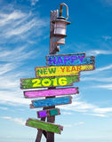 2016 happy new year written on a wooden sign Stock Image