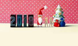 2018 Happy new year Xmas party poster. Santa Claus clothespins kids, fir tree decorated, gifts in bags and vintage. Letterpress digits. Copy space, creative royalty free stock photos