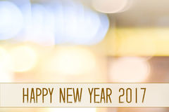 Happy New Year 2017 year on abstract blur festive bokeh background stock images