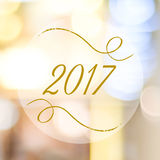 Happy New Year 2017 year on blur bokeh background. Happy New Year 2017 year on abstract blur festive bokeh background Stock Photo