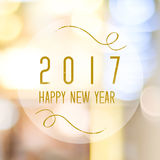 Happy New Year 2017 year on blur bokeh background. Happy New Year 2017 year on abstract blur festive bokeh background Royalty Free Stock Image