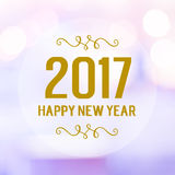 Happy New Year 2017 year on blur bokeh background. Happy New Year 2017 year on abstract blur festive bokeh background Royalty Free Stock Photos
