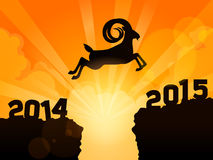 Happy new year 2015 year of goat. A goat jumps from 2014 to 2015