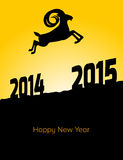 Happy new year 2015 year of goat. A goat jumps from 2014 to 2015 Royalty Free Stock Photography