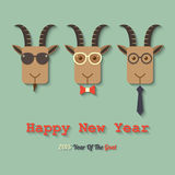 Happy new year 2015 year of the goat. Three goats wearing glasses within 2015 year of the goat sign Stock Images