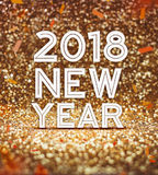 Happy new year 2018 year number with confetti at sparkling golde Stock Photos