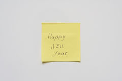 Happy new year on yellow sticker. royalty free stock images