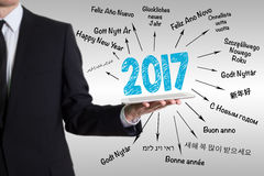 2017 Happy New Year. Young man holding a tablet computer.  Stock Photo