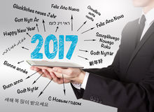 2017 Happy New Year, young man holding a tablet computer.  Stock Image