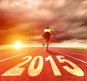 Happy new year 2015. young man running with sunrise. Background stock images