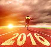 Happy new year 2016. young man running stock photography