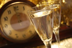 Happy New Years. Two glasses of champagne and clock Stock Images