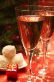Happy New Years. Two glasses of champagne and candy Royalty Free Stock Photo