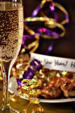 Happy new years. New years eve celebration with champagne and ribbons Stock Photos