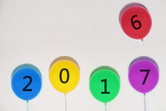Happy New Years 2017 balloons. year changes balloon from 2016 to 2017 on white wall with copy space. Happy New Years 2017 balloons. year changes balloon from Stock Photography