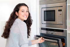 Happy newbie cook woman Stock Image