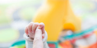 Happy newborn baby playing Stock Photography