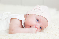 Happy newborn baby portrait, looking at the camera with her blue big eyes. Royalty Free Stock Photography