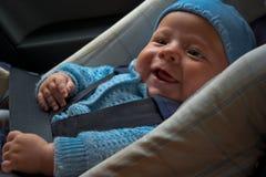 Happy newborn in car seat royalty free stock photo