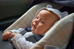 Happy newborn in car seat Stock Photos