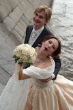 Happy newly married couple. Groom and bride blowing a kiss Royalty Free Stock Image
