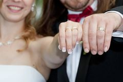 Happy newly married couple. Showing off their new wedding rings stock photos