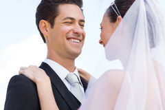 Happy newly wed couple against sky Stock Images
