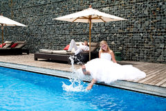 Happy newly wedding couple near pool Royalty Free Stock Photography