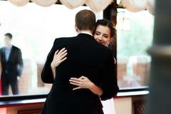 Happy newlywed bride and groom dancing at wedding reception clos. Eup Stock Photography