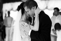 Happy newlywed bride and groom dancing at wedding reception clos Stock Images