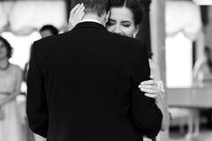 Happy newlywed bride and groom dancing at wedding reception clos. Eup b&w Royalty Free Stock Image