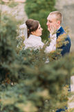 Happy newlywed couple, bride and groom, at wedding walk on the beautiful green park Stock Photography