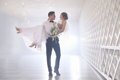 Free Happy Newlywed Couple Dancing In Festive Hall Stock Photo - 181251760