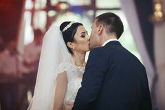 Happy newlywed couple dancing and kissing at wedding reception c Royalty Free Stock Photos